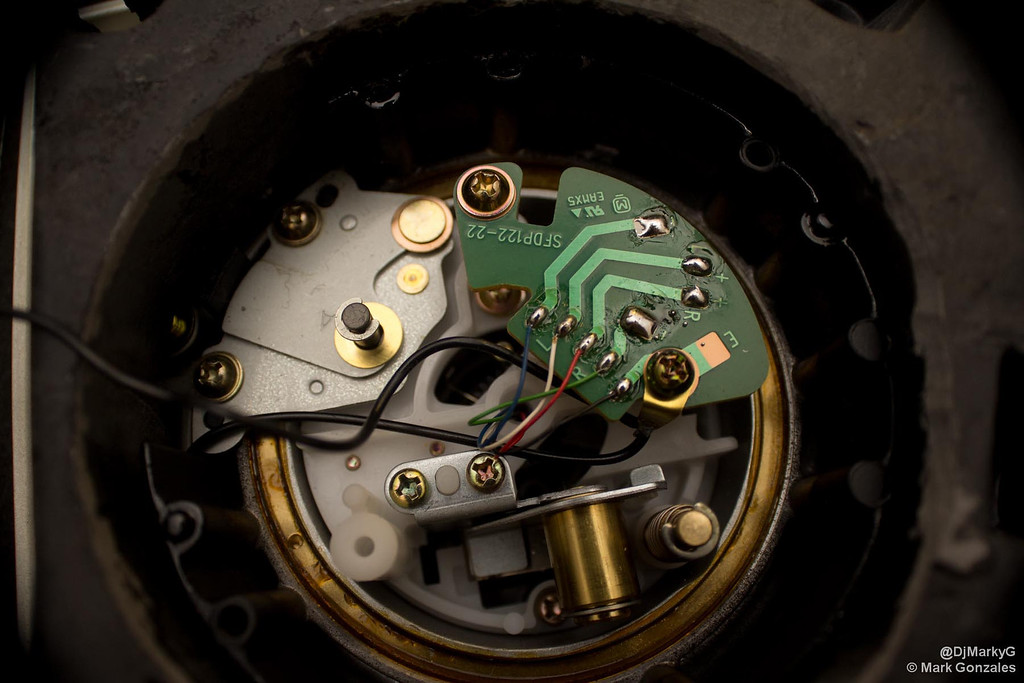 replacing rca cables and self grounding technics 1200 turntables remove the metal plates to expose the audio circuit
